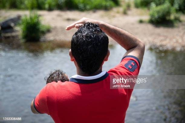 Marvin holds his son Neysel 10 weeks while at a park on June 25 2020 in Stamford Connecticut Marvin his wife Zully and their son Junior were sickened...
