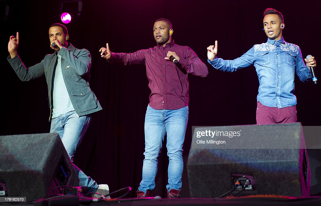 Marvin Humes, Aston Merrygold and JB Gill of JLS perform on stage on Day 1 of Fusion Festival 2013 at Cofton Park on August 31, 2013 in Birmingham, England.