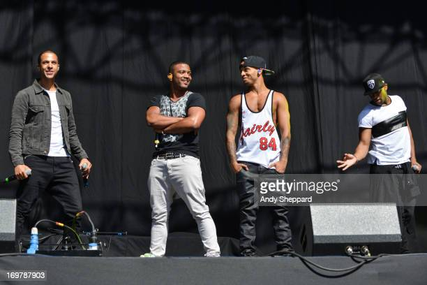 Marvin Humes JB Gill Aston Merrygold and Ortise Williams of the band JLS perform on stage at Allstarz Summer Party 2013 at Madejski Stadium on June 1...