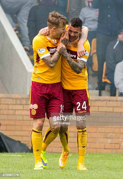 Marvin Johnson celebrates a goal with Lee Erwin of Motherwell during the Scottish Premiership playoff final 2nd leg between Motherwell and Rangers at...