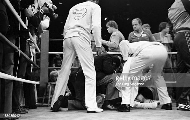 Marvin Johnson is checked by his trainers after he is knocked out by Michael Spinks after the fight at the Resorts International in Atlantic City New...