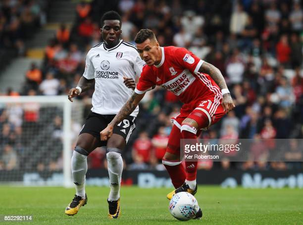 Marvin Johnson of Middlesbrough holds off the challenge of Sheyi Ojo of Fulham during the Sky Bet Championship match between Fulham and Middlesbrough...