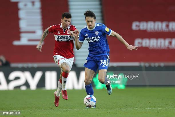 Marvin Johnson of Middlesbrough in action with Perry Ng of Cardiff City during the Sky Bet Championship match between Middlesbrough and Cardiff City...