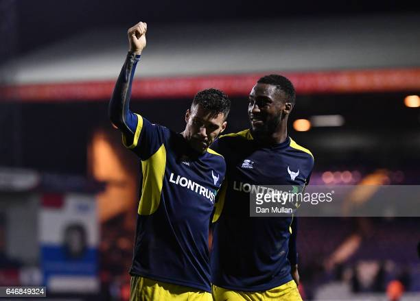 Marvin Johnson of Oxford United and Cheyenne Dunkley of Oxford United acknowledge the fans following their side's victory during the EFL Checkatrade...