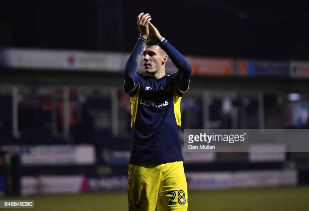 Marvin Johnson of Oxford United applauds the fans following his side's victory during the EFL Checkatrade Trophy Semi Final match between Luton Town...