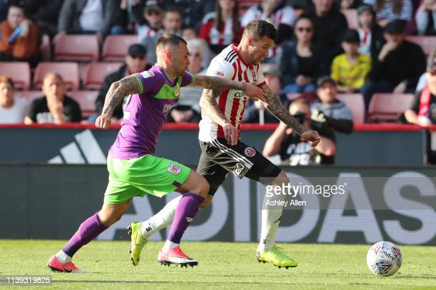 Marvin Johnson of Sheffield United runs into the final third as Eros Pisano of Bristol City challenges during the Sky Bet Championship match between...