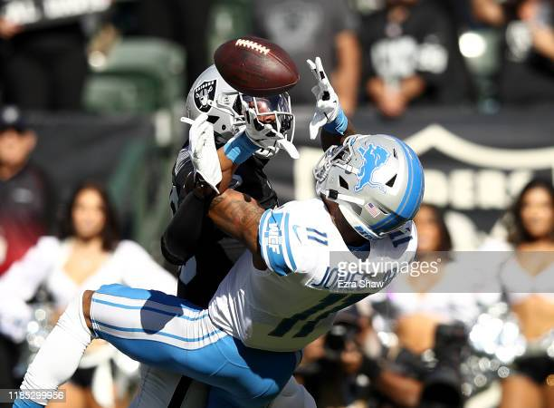 Marvin Jones Jr #11 of the Detroit Lions catches the ball while he is covered by Daryl Worley of the Oakland Raiders at RingCentral Coliseum on...