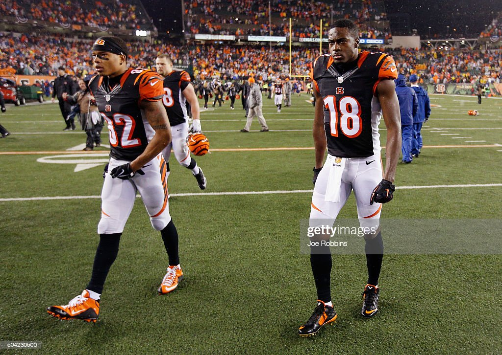 Marvin Jones #82 of the Cincinnati Bengals and A.J. Green #18 walk off the field after the Pittsburgh Steelers defeat the Cincinnati Bengals with a score of 18 to 16 to win the AFC Wild Card Playoff game at Paul Brown Stadium on January 9, 2016 in Cincinnati, Ohio.