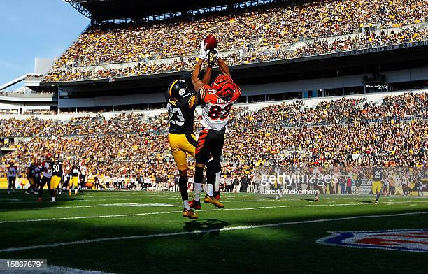 Marvin Jones of the Cincinnati Bengals goes up to catch a pass in the end zone before having it knocked loose by defender Keenan Lewis of the...