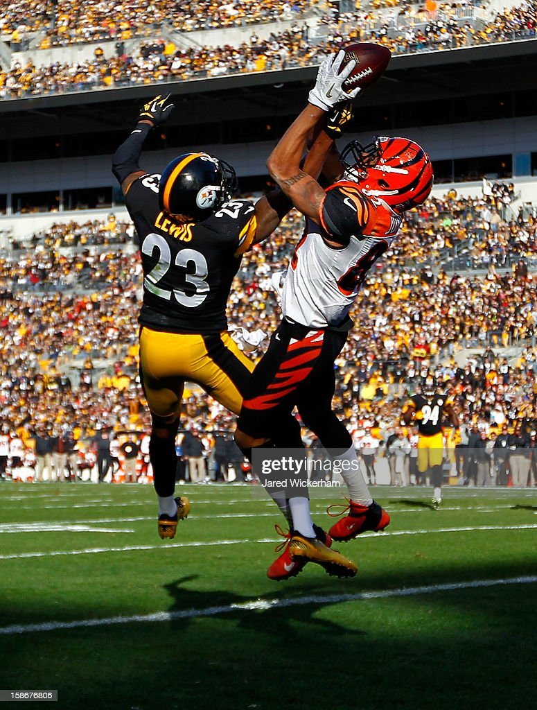 Marvin Jones #82 of the Cincinnati Bengals goes up to catch a pass in the end zone before having it knocked loose by defender Keenan Lewis #23 of the Pittsburgh Steelers in the first half during the game at Heinz Field on December 23, 2012 in Pittsburgh, Pennsylvania.
