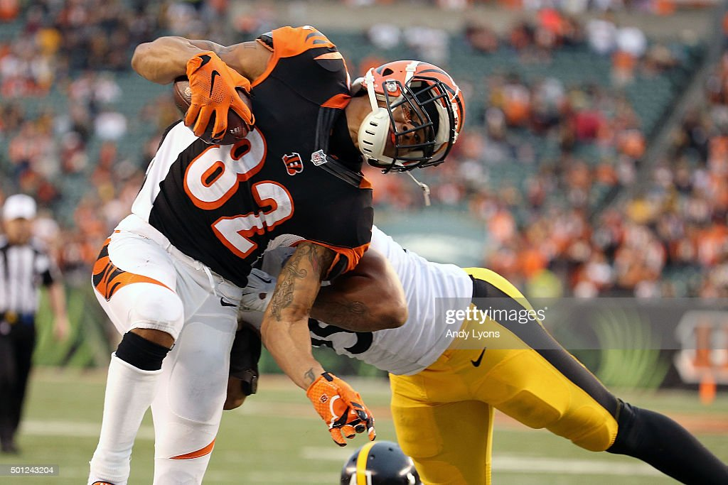 Marvin Jones #82 of the Cincinnati Bengals is knocked out of bounds by Jarvis Jones #95 of the Pittsburgh Steelers during the fourth quarter at Paul Brown Stadium on December 13, 2015 in Cincinnati, Ohio. Pittsburgh defeated Cincinnati 33-20.