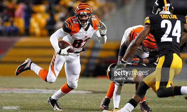 Marvin Jones of the Cincinnati Bengals runs after making the catch against the Pittsburgh Steelers during the game on December 15, 2013 at Heinz...
