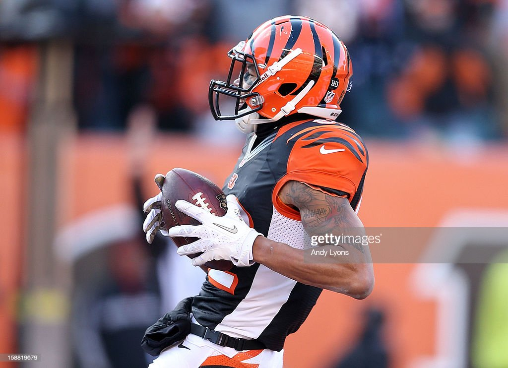 Marvin Jones #82 of the Cincinnati Bengals runs for a touchdown during the NFL game against the Baltimore Ravens at Paul Brown Stadium on December 30, 2012 in Cincinnati, Ohio.