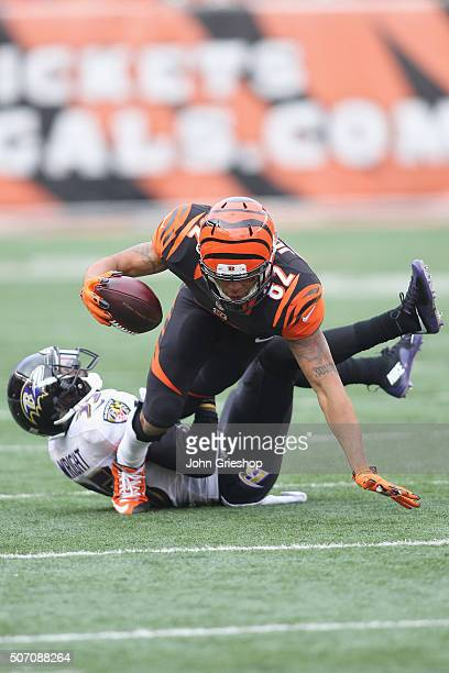 Marvin Jones of the Cincinnati Bengals runs the football upfield against Shareece Wright of the Baltimore Ravens during their game at Paul Brown...