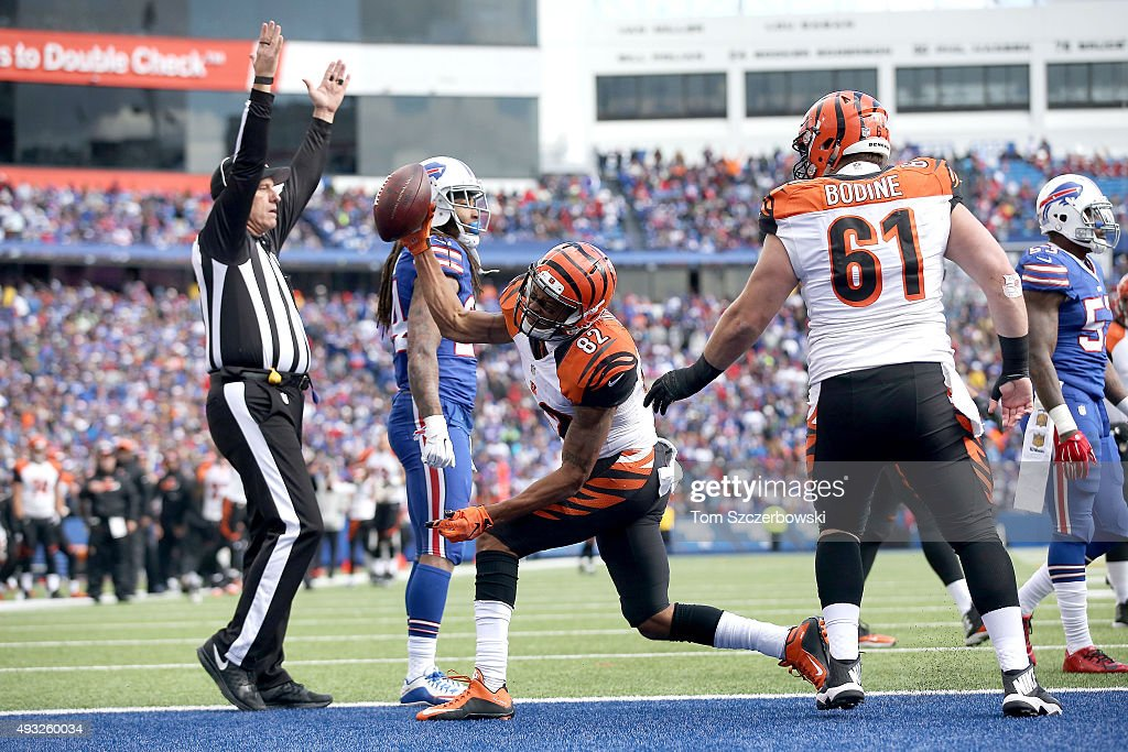 Marvin Jones #82 of the Cincinnati Bengals spikes the ball after a touchdown against the Buffalo Bills during the second half at Ralph Wilson Stadium on October 18, 2015 in Orchard Park, New York.