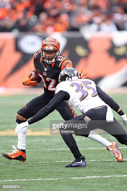 Marvin Jones of the Cincinnati Bengals stiff arms Shareece Wright of the Baltimore Ravens while running with the ball during the second quarter at...