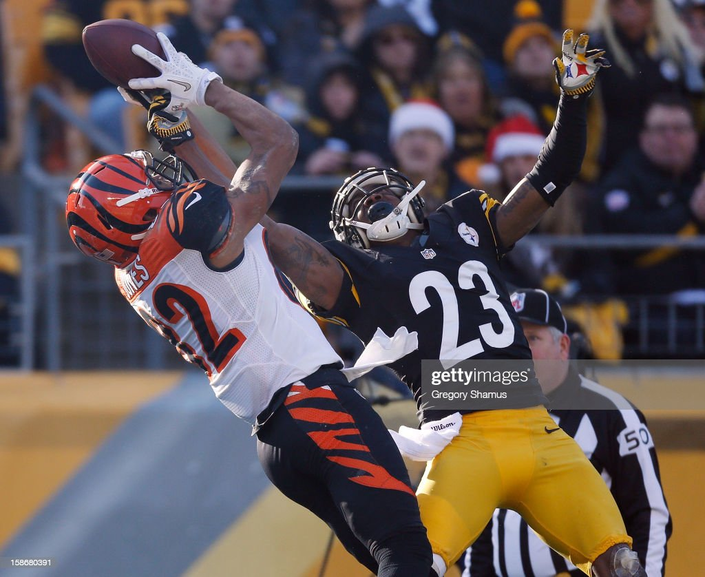 Marvin Jones #82 of the Cincinnati Bengals tries to make a second quarter catch but its broken up by Keenan Lewis #23 of the Pittsburgh Steelers at Heinz Field on December 23, 2012 in Pittsburgh, Pennsylvania.