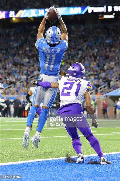 Marvin Jones of the Detroit Lions catches a second quarter touchdown in front of Mike Hughes of the Minnesota Vikings at Ford Field on October 20,...