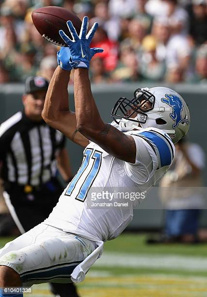 Marvin Jones of the Detroit Lions catches a touchdown pass in the 4th quarter against the Green Bay Packers at Lambeau Field on September 25, 2016 in...