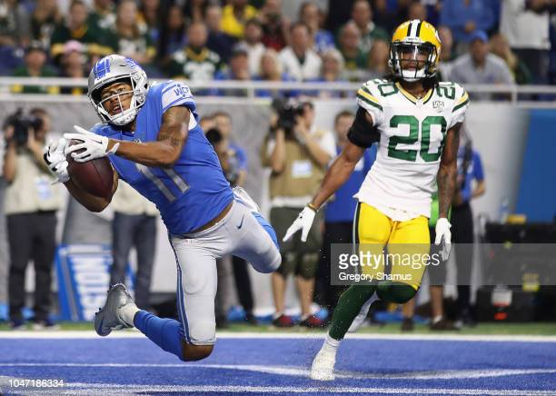 Marvin Jones of the Detroit Lions catches a touchdown pass infant of Kevin King of the Green Bay Packers during the first half at Ford Field on...
