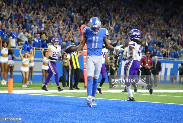 Marvin Jones of the Detroit Lions celebrates a first quarter touchdown during the game against the Minnesota Vikings at Ford Field on October 20,...