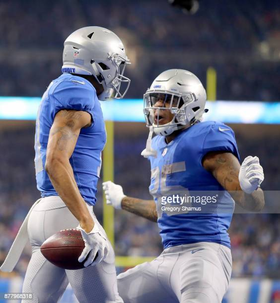 Marvin Jones of the Detroit Lions celebrates his touchdown catch with Theo Riddick of the Detroit Lions during the fourth quarter against the...