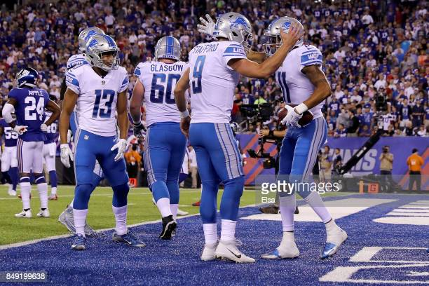 Marvin Jones of the Detroit Lions celebrates with Matthew Stafford after scoring a 27 yard touchdown in the first quarter against the New York Giants...