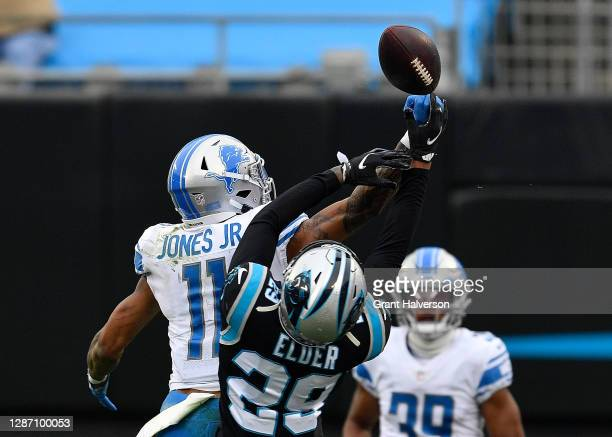 Marvin Jones of the Detroit Lions fails to pull in this fourth down reception as he is defended by Corn Elder of the Carolina Panthers during the...