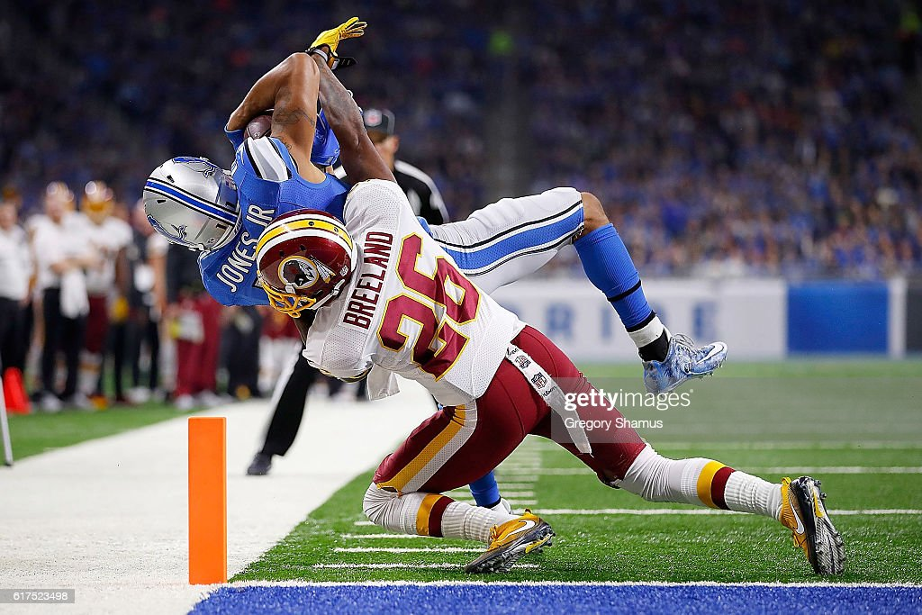 Marvin Jones #11 of the Detroit Lions is taken down at the goal line by Bashaud Breeland #26 of the Washington Redskins during third quarter action at Ford Field on October 23, 2016 in Detroit, Michigan. The Lions defeated the Redskins 20-17.