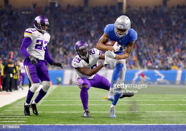 Marvin Jones of the Detroit Lions makes a touchdown catch against Terence Newman of the Minnesota Vikings and Xavier Rhodes during the fourth quarter...