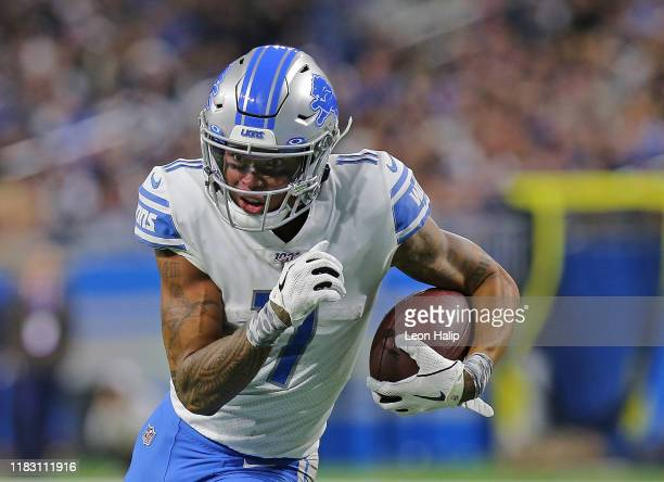 Marvin Jones of the Detroit Lions scores a third quarter touchdown during the game against the Dallas Cowboys at Ford Field on November 17, 2019 in...