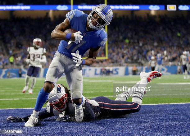Marvin Jones of the Detroit Lions scores a touchdown against Jason McCourty of the New England Patriots during the third quarter at Ford Field on...