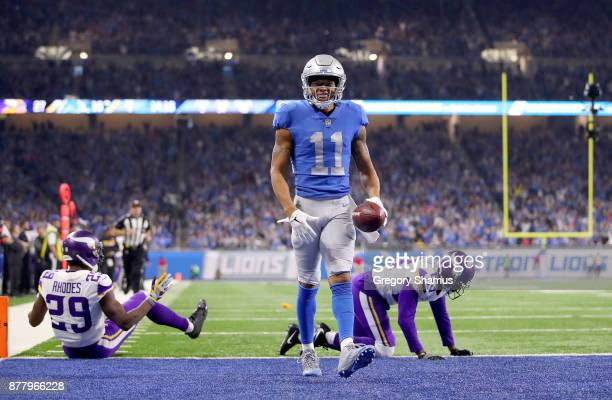 Marvin Jones of the Detroit Lions walks into the end zone after his fourth quarter touchdown against the Minnesota Vikings at Ford Field on November...