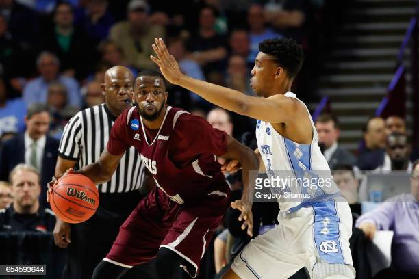 Marvin Jones of the Texas Southern Tigers drives against Tony Bradley of the North Carolina Tar Heels in the first half during the first round of the...
