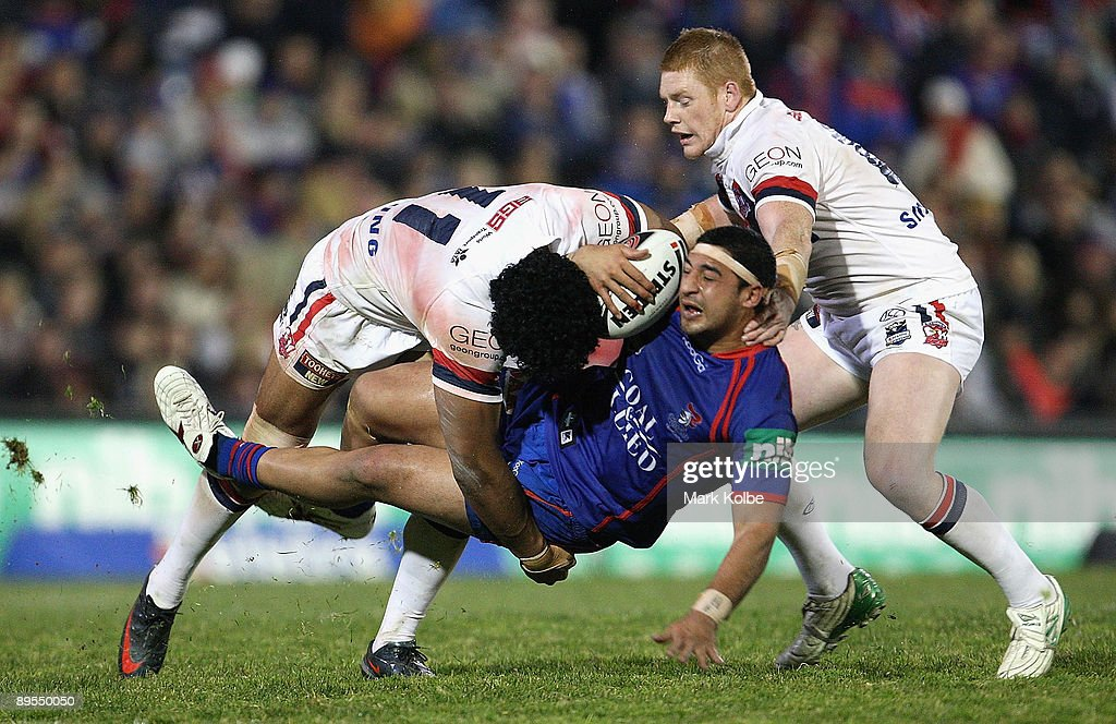 Marvin Karawana of the Knights is tackled during the round 21 NRL match between the Newcastle Knights and the Sydney Roosters at EnergyAustralia Stadium on August 1, 2009 in Newcastle, Australia.