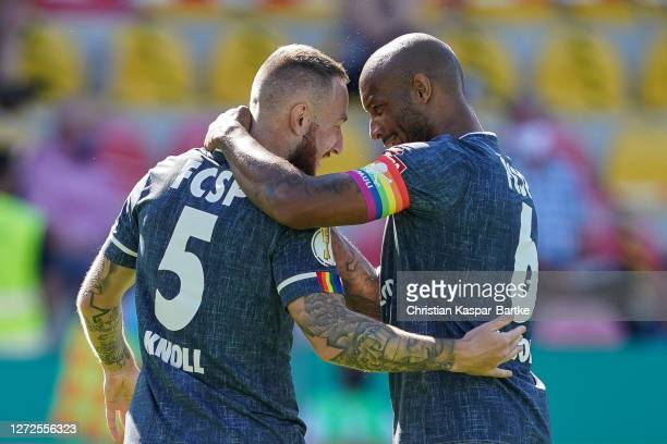 Marvin Knoll of FC St. Pauli celebrates after scoring his team`s first goal with team mate Christopher Avevor of FC St. Pauli during the DFB Cup...