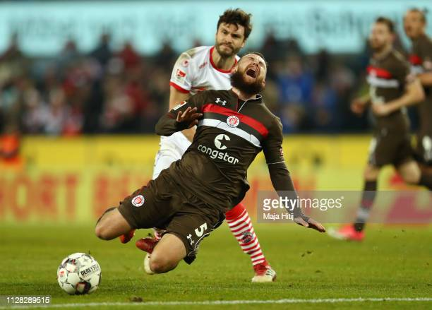 Marvin Knoll of FC St Pauli is fouled by Jonas Hector of FC Koln during the Second Bundesliga match between 1 FC Koeln and FC St Pauli at...
