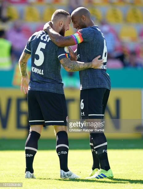 Marvin Knoll of St Pauli celebrates with Christopher Avevor after scoring his team's first goal during the DFB Cup first round match between SV...