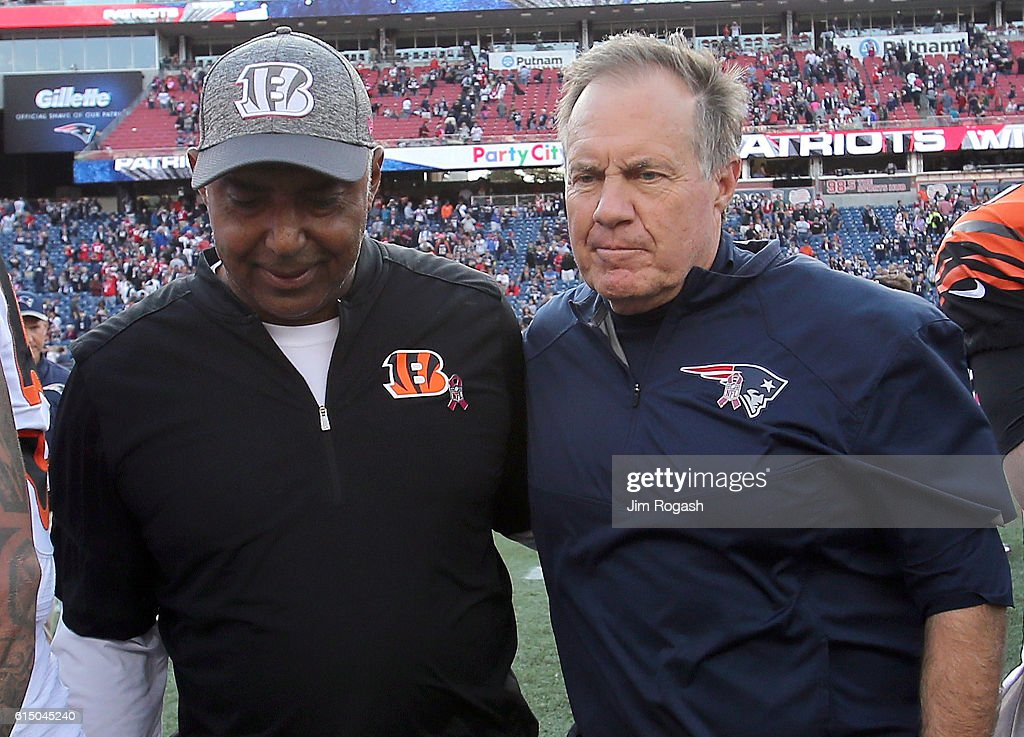 Marvin Lewis, head coach of the Cincinnati Bengals, talks with Bill Belichick, head coach of the New England Patriots, after their game at Gillette Stadium on October 16, 2016 in Foxboro, Massachusetts. The Patriots won the game.