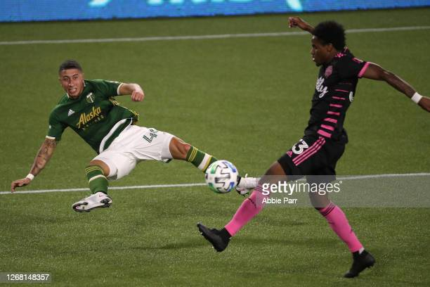 Marvin Loria of Portland Timbers kicks the ball past Joevin Jones of Seattle Sounders in the second half at Providence Park on August 23, 2020 in...