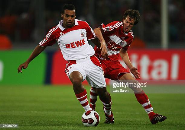 Marvin Matip of Cologne in action with Stephan Fuerstner of Munich during a friendly match between 1 FC Cologne and Bayern Munich at the Rhein...