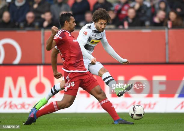 Marvin Matip of FC Ingolstadt 04 challenges Fabian Johnson of Borussia Moenchengladbach during the Bundesliga match between FC Ingolstadt 04 and...