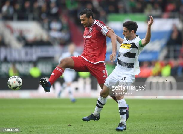 Marvin Matip of FC Ingolstadt 04 challenges Lars Stindl of Borussia Moenchengladbach during the Bundesliga match between FC Ingolstadt 04 and...