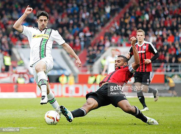 Marvin Matip of FC Ingolstadt tackles Lars Stindl of Borussia Monchengladbach during the Bundesliga match between FC Ingolstadt and Borussia...