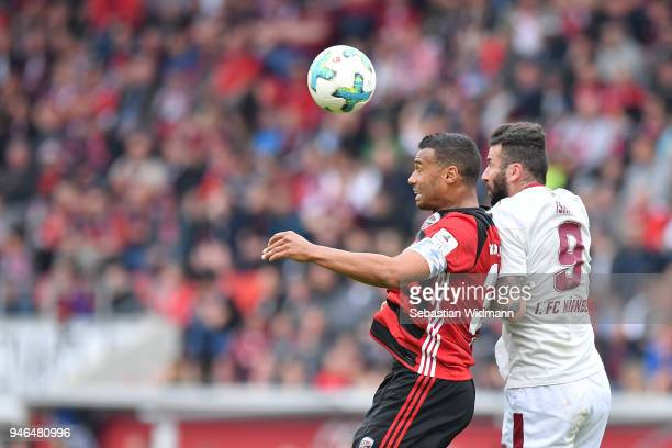 Marvin Matip of Ingolstadt and Mikael Ishak of Nuernberg jump for a header during the Second Bundesliga match between FC Ingolstadt 04 and 1 FC...
