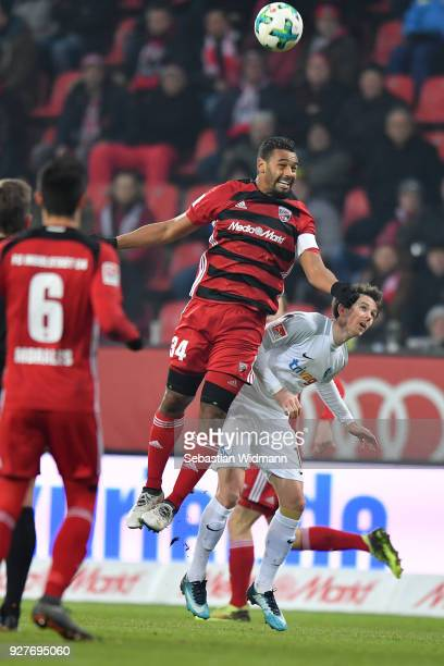 Marvin Matip of Ingolstadt and Robbie Kruse of Bochum jump for a header during the Second Bundesliga match between FC Ingolstadt 04 and VfL Bochum...