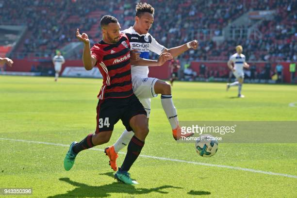Marvin Matip of Ingolstadt and Roberto Massimo of Bielefeld fight for the ball during the Second Bundesliga match between FC Ingolstadt 04 and DSC...