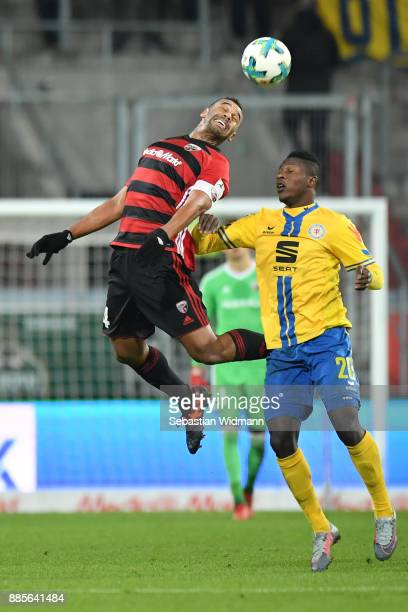 Marvin Matip of Ingolstadt and Suleiman Abdullahi of Braunschweig jump for a header during the Second Bundesliga match between FC Ingolstadt 04 and...
