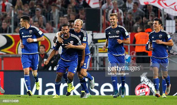 Marvin Matip of Ingolstadt celebrates scoring the 11 goal with Tobias Levels of Ingolstadt during the Bundesliga match between 1 FC Koeln and FC...