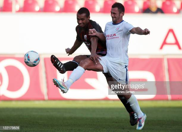 Marvin Matip of Ingolstadt fights for the ball with Marcel Schied of Rostock during the Second Bundesliga match between FC Ingolstadt and Hansa...